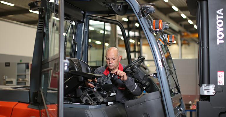 Toyota technician servicing a truck